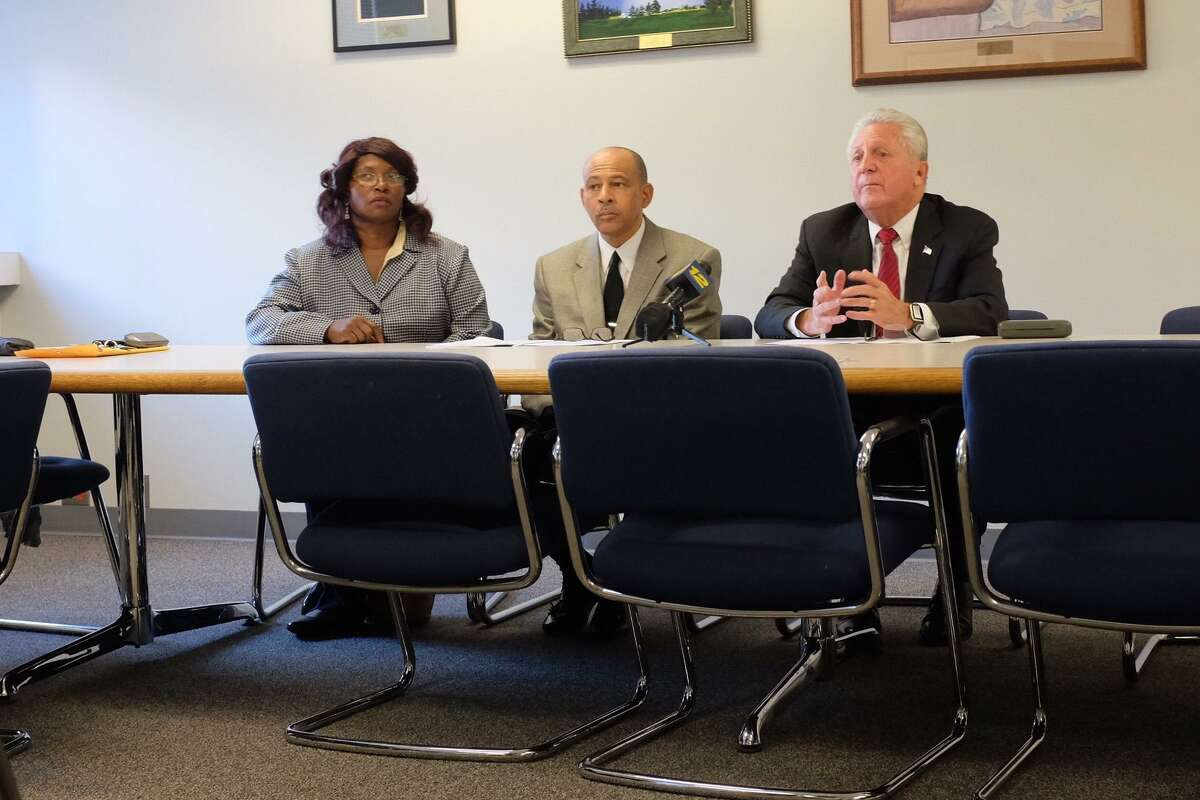 Daisy Franklin and Jeffrey Ingraham, of the Fair Housing Advisory Commission, present the findings of a report on housing discrimination with Mayor Harry Rilling on Oct.19.