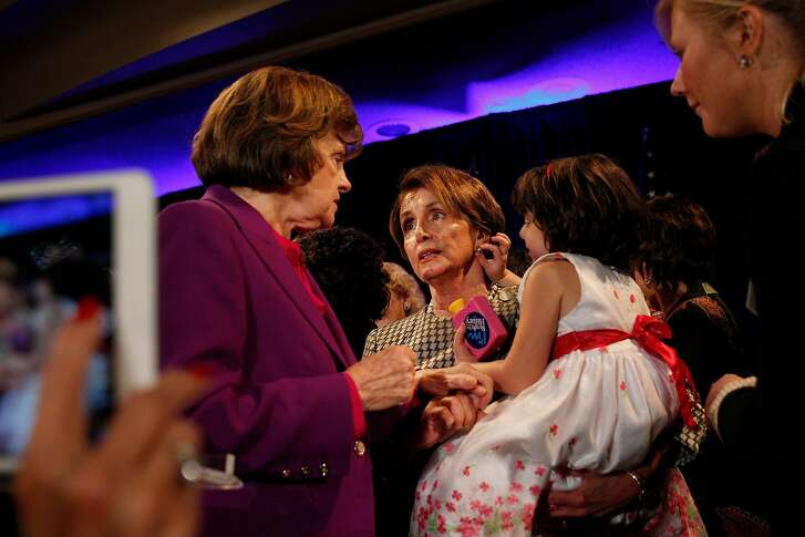 Senator Dianne Feinstein (l to r) talks with House Minority Leader Nancy Pelosi who holds her granddaughter Bella Kaufman, 5, as they stand on stage after former Secretary of State Hillary Rodham Clinton (not shown)  spoke at the DCCC Ultimate Women's Power Lunch at the Fairmont Hotel  on Monday, October 20, 2014 in San Francisco, Calif.