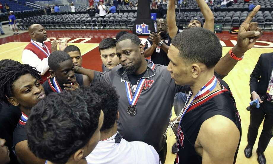 Coach Rodney Clark encourages his palyers after Wagner loses to Houston Cypress Falls in the 6A state championship basketball game for class 6A boys at the Alamodome on March 11, 2017. Photo: Tom Reel /San Antonio Express-News / 2017 SAN ANTONIO EXPRESS-NEWS