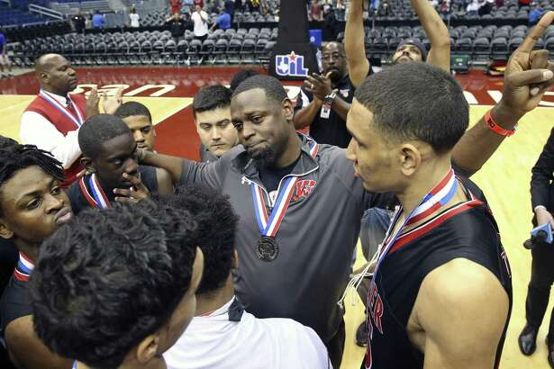 Coach Rodney Clark encourages his palyers after Wagner loses to Houston Cypress Falls in the 6A state championship basketball game for class 6A boys at the Alamodome on March 11, 2017.