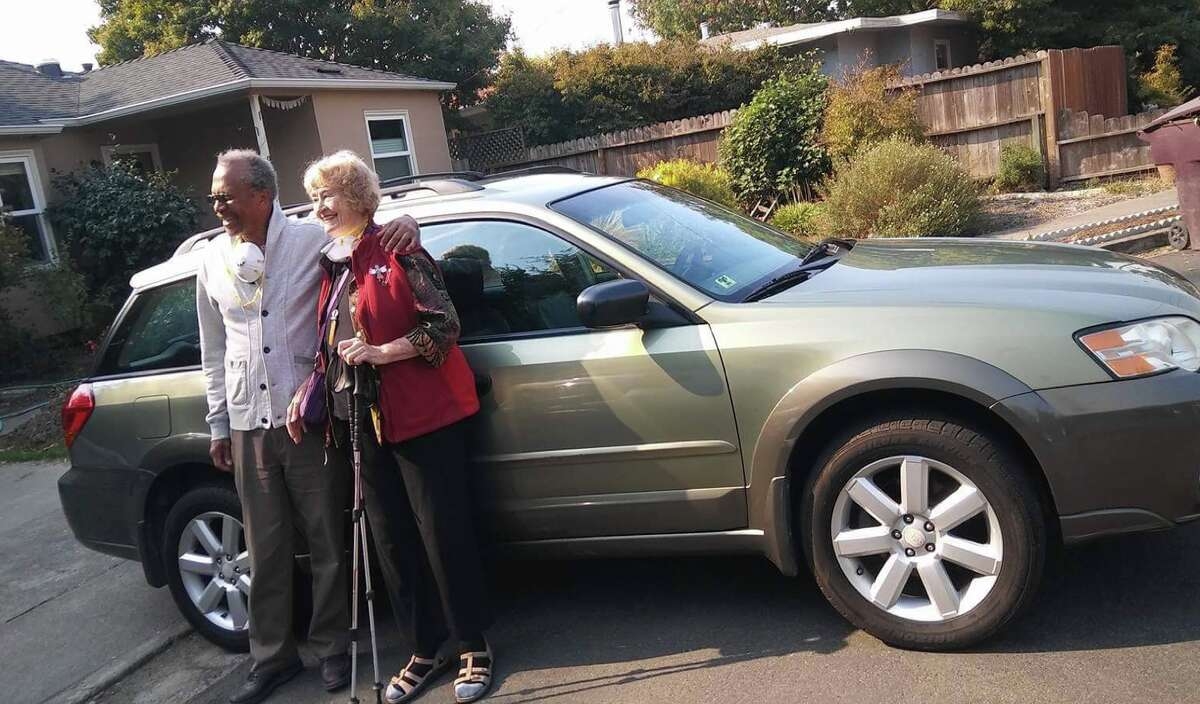 Sara and Sam with their Subaru after the CHP returned it to them.