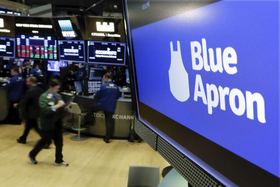Blue Apron's stock and fortunes have suffered amid strong competition since it went public at the end of June. The company is cutting about 320 jobs. Photo: Richard Drew, Associated Press