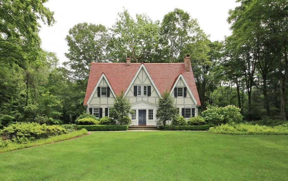 The French Normandy Tudor house at 1060 Hillside Road is affectionately known in the Greenfield Hill neighborhood as The Gingerbread House. Photo: Contributed Photos