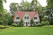 The French Normandy Tudor house at 1060 Hillside Road is affectionately known in the Greenfield Hill neighborhood as The Gingerbread House.