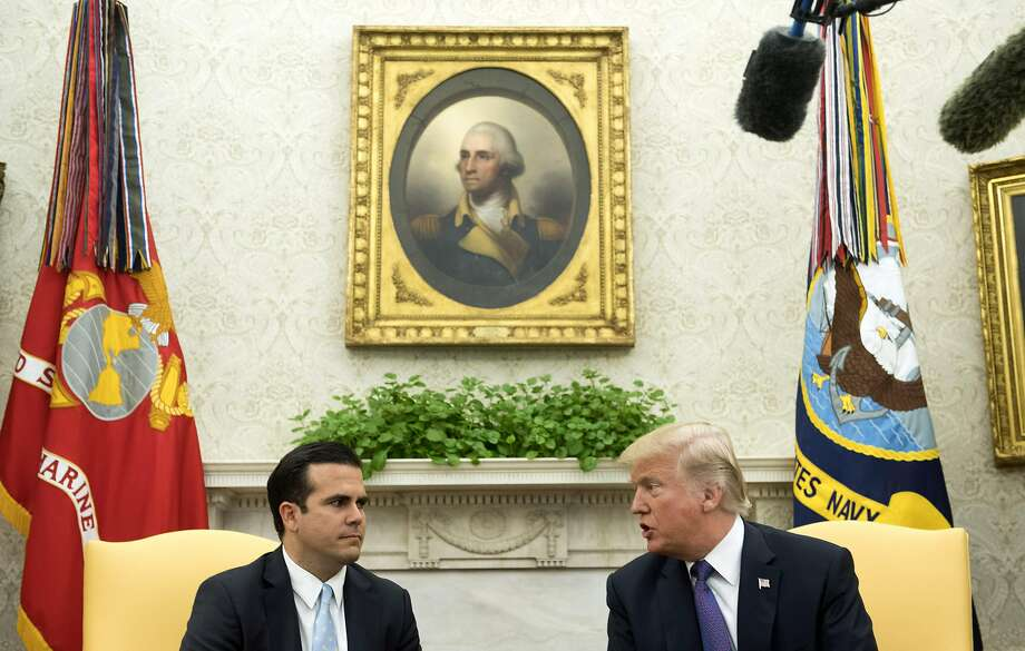 President Trump speaks with Puerto Rico Gov. Ricardo Rossello about hurricane assistance at the White House. Photo: Pool, Getty Images