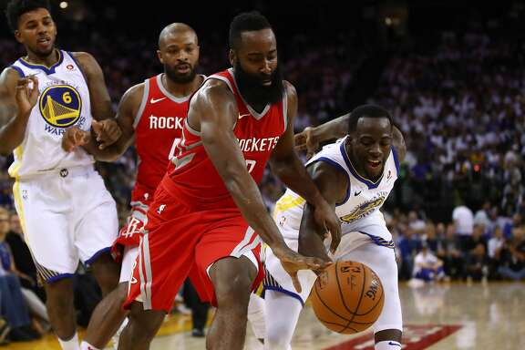 OAKLAND, CA - OCTOBER 17:  Draymond Green #23 of the Golden State Warriors defends James Harden #13 of the Houston Rockets during their NBA game at ORACLE Arena on October 17, 2017 in Oakland, California. NOTE TO USER: User expressly acknowledges and agrees that, by downloading and or using this photograph, User is consenting to the terms and conditions of the Getty Images License Agreement.  (Photo by Ezra Shaw/Getty Images)