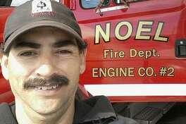 Firefighter Garrett Paiz, 38, died when truck ran off road.