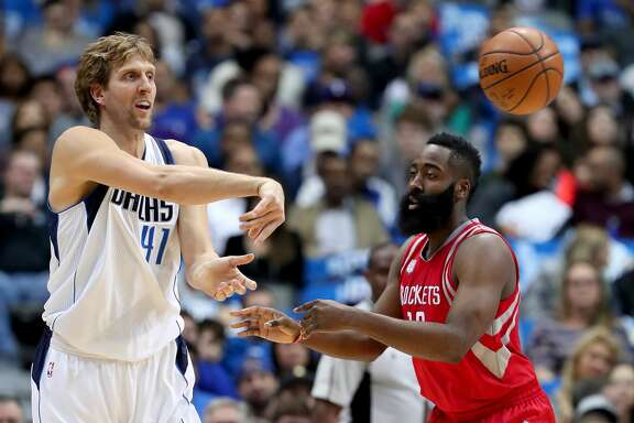 DALLAS, TX - DECEMBER 27:  Dirk Nowitzki #41 of the Dallas Mavericks passes the ball against James Harden #13 of the Houston Rockets in the first half at American Airlines Center on December 27, 2016 in Dallas, Texas. NOTE TO USER: User expressly acknowledges and agrees that, by downloading and or using this photograph, User is consenting to the terms and conditions of the Getty Images License Agreement.  (Photo by Tom Pennington/Getty Images)