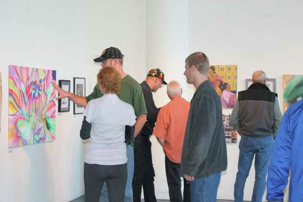 Attendees view a painting at Hartford Artspace.