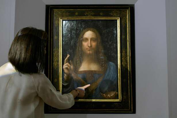 A Christies representative speaks after Leonardo da Vinci's 'Salvator Mundi' painting was unveiled in Hong Kong on OCt. 13, 2017.
