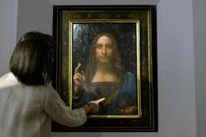 A Christies representative speaks after Leonardo da Vinci's 'Salvator Mundi' painting was unveiled in Hong Kong on OCt. 13, 2017.