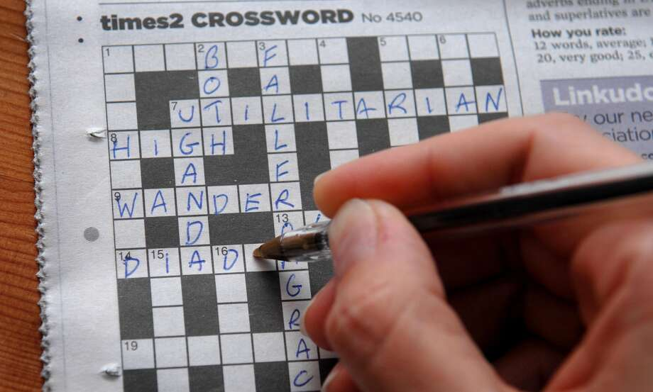Crosswords: a world of numbers and letters that always, in the end, fits together perfectly. Photo: Clive Gee - PA Images / Getty Images