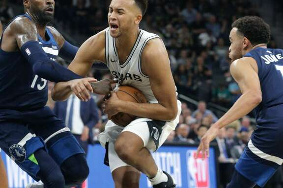 Kyle Anderson protects the balls as he rools into the lane as the Spurs defeated Minnesota in the season opener at the AT&T Center on Oct. 18, 2017.