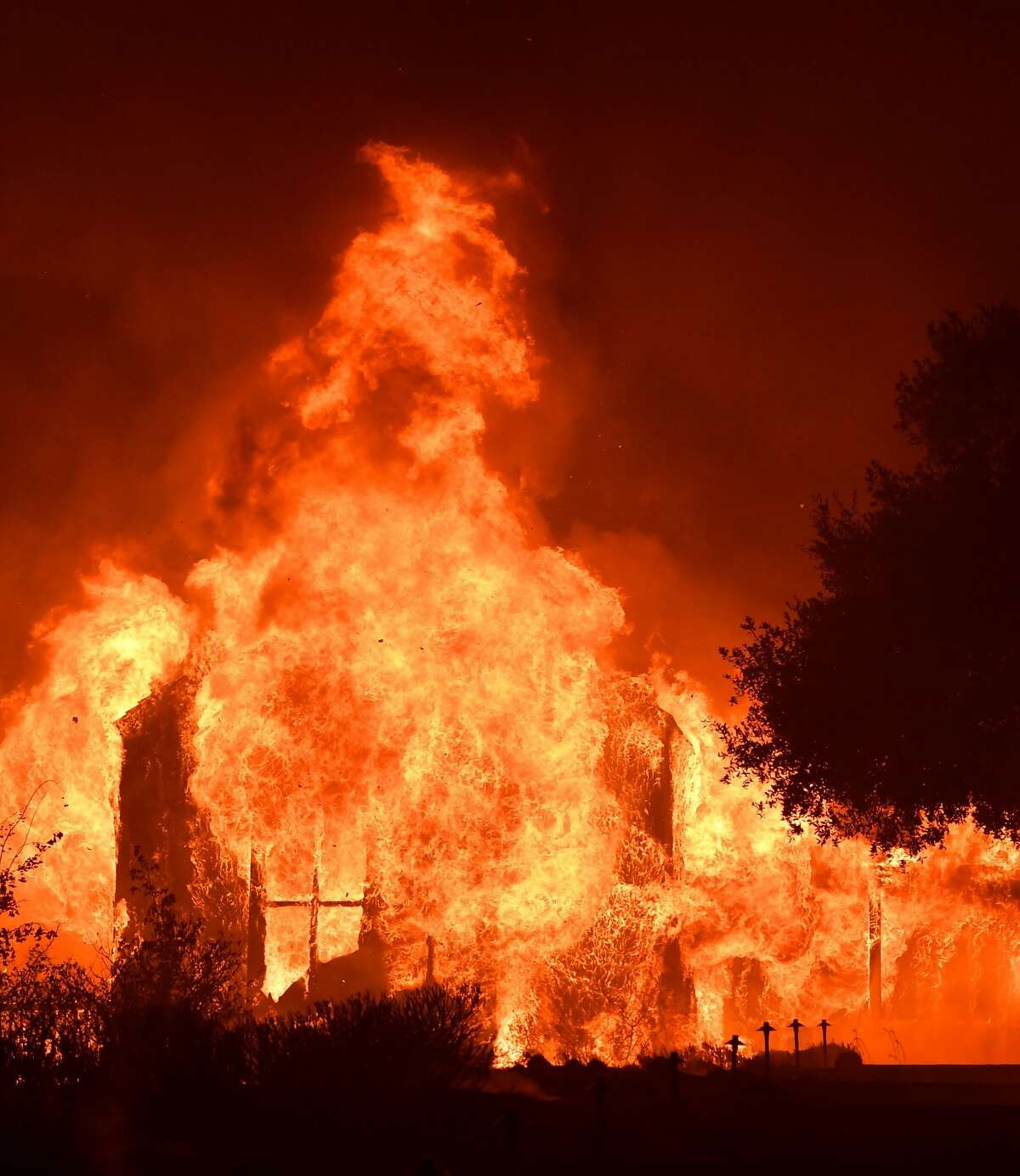 The main building at Paras Vinyards burns in the Mount Veeder area of Napa in California on October 10, 2017. Firefighters battled wildfires in California's wine region on Tuesday as the death toll rose to 15 and thousands were left homeless in neighborhoods reduced to ashes. / AFP PHOTO / JOSH EDELSONJOSH EDELSON/AFP/Getty Images