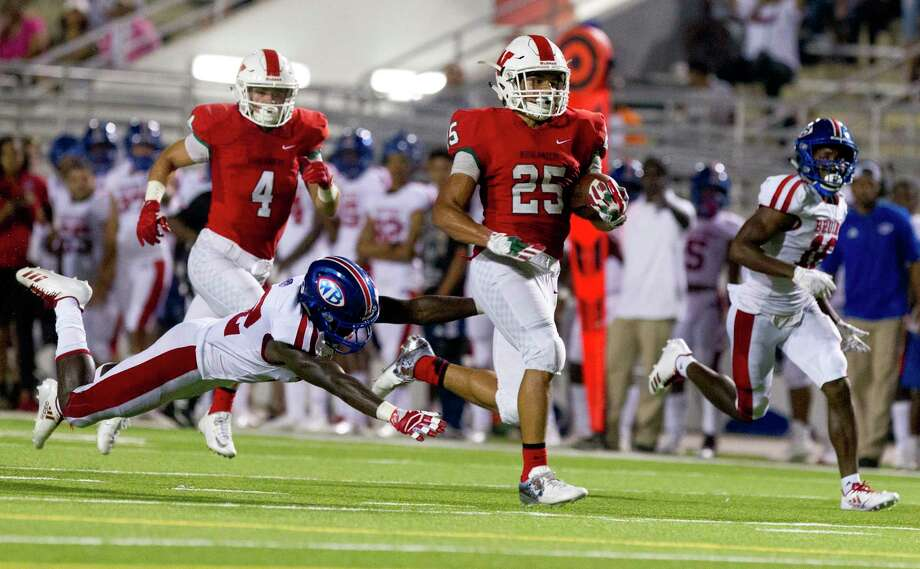 The Woodlands running back Bryeton Gilford (25) runs past the outstretch arms of Beaumont West Brook defensive back O'Brien Coleman (22) during the fourth quarter of a District 12-6A high school football game at Woodforest Bank Stadium on Thursday, Oct. 12, 2017, in Shenandoah. The Woodlands defeated Beaumont West Brook 35-21. Photo: Jason Fochtman, Staff Photographer / © 2017 Houston Chronicle