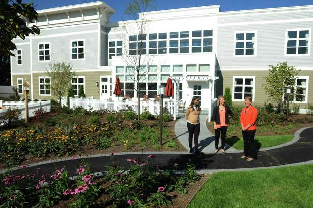 Tasha Chimbila, life enrichment director, Addie Ricci, business operations manager and Terry Tumpane, executive director, show off the beautiful courtyard at Bridges by Epoch, a newly constructed assisted living center with 64 units. The facility at 123 Richards Avenue in Norwalk, Conn. serves people with memory loss from Alzheimer's disease and other forms of dementia.