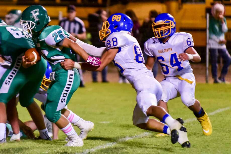 Hale Center's Carlos Alvidrez, 88, grabs Floydada's Jose Lira, 26, from behind as the Owls' Ancil Flores, 64, moves in to help during a District 2-2A, Division I football game last week. Hale Center lost the district opener and will try to even their district record when they host Sundown Friday. Photo: Photo Courtesy Of Albert Gomez Photography