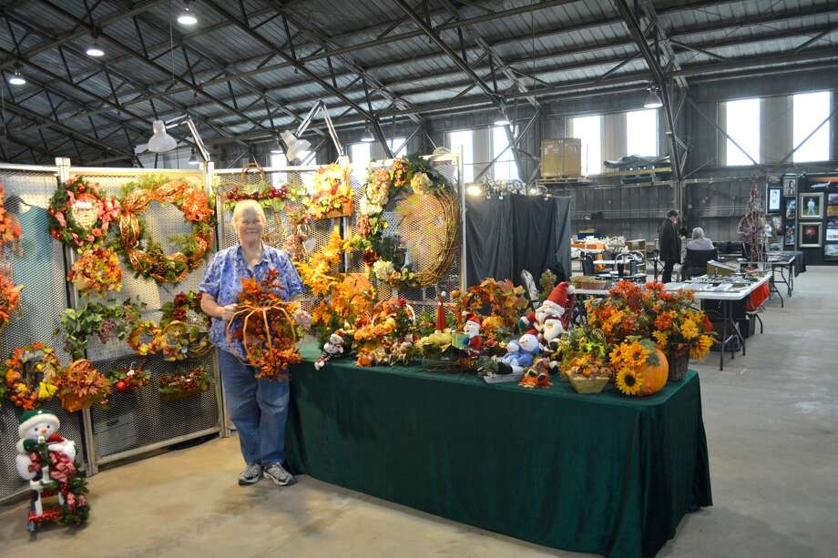 Betty Foster stands amid autumn-themed decorations filling her booth at the 43rd annual Running Water Draw Arts & Crafts Festival. Sponsored by the Plainview Rotary Club, the three-day event runs 10 a.m. to 6 p.m. Friday and Saturday, and noon-5 p.m. Sunday, Oct. 20-22, at the Ollie Liner Center. Admission is $2 for adults and $1 for children. Stan and Betty Foster serve as event coordinators. This year's arts and crafts festival features 110 booths along with the traditional silent auction. Each exhibitor has contributed at least one item to the silent auction, with the original price attached. Those attending the arts and crafts fair are invited to bid on each item. The auction ends at 4 p.m. Sunday, with each individual item going to the person making the highest bid for that particular item.