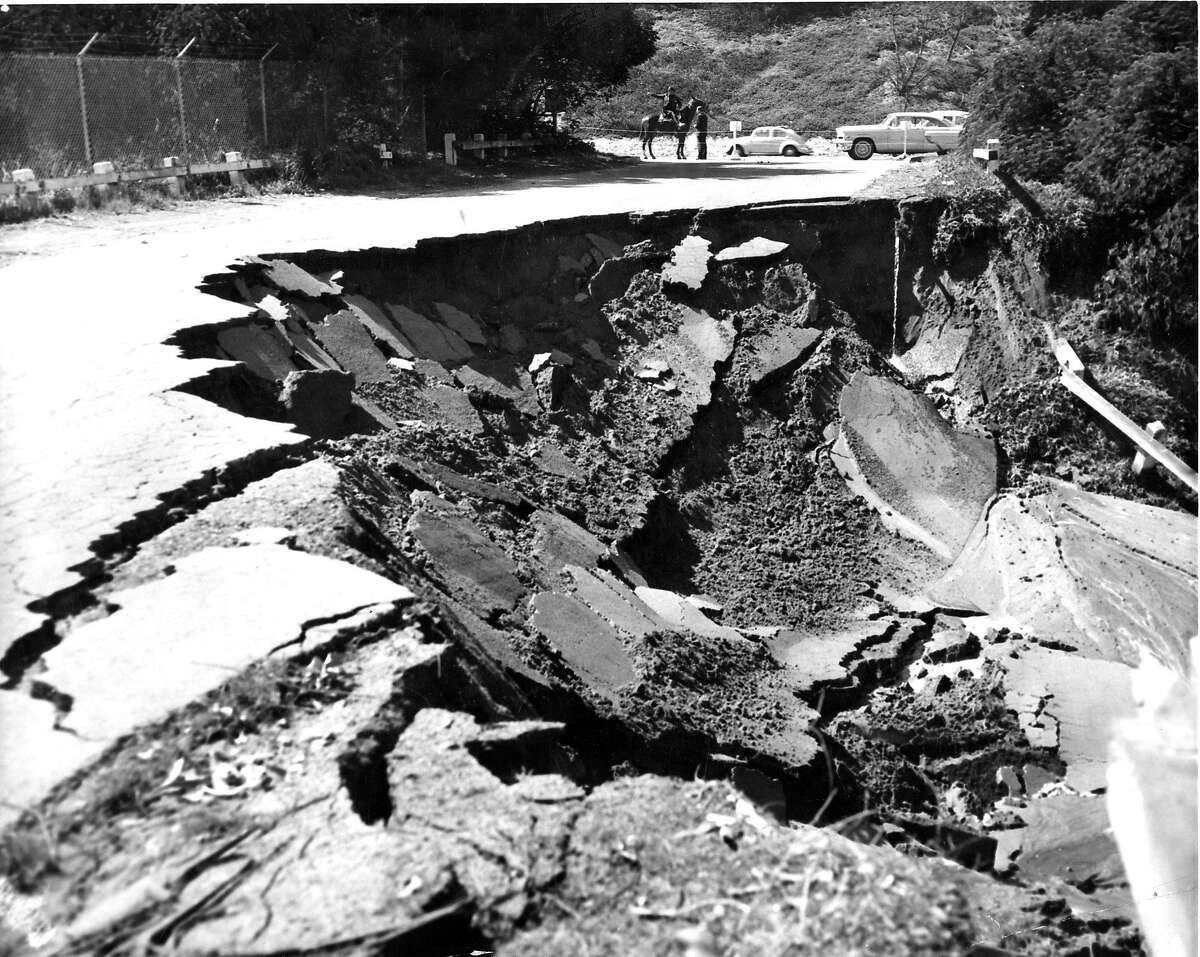 Police blocked the road as this section of the boulevard broke off into Lake Merced after the earthquake struck, March 22, 1957