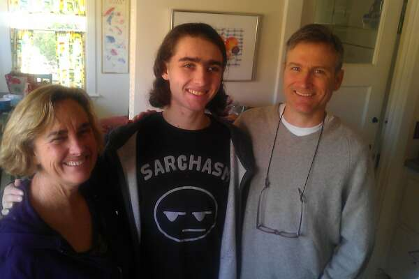 Sasha Fleischman poses with Sasha's parents, Karl Fleischman and Debbie Crandall, at their home on Saturday, November 30, 2013 in Oakland, Calif.