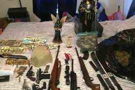 Law enforcement officers seized 6.5 pounds of marijuana, three rifles and four handguns from a residence in south Laredo located within 100 yards of LBJ High School.