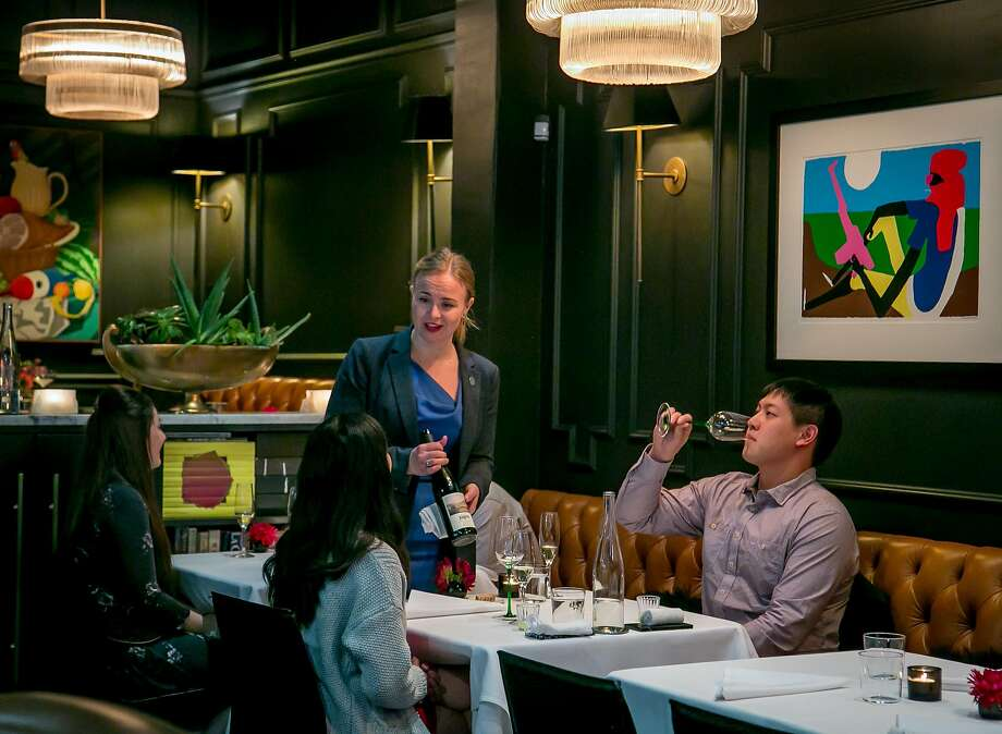 Sommelier Wendy Shoemaker offers wine to diners at Californios. Photo: John Storey, Special To The Chronicle
