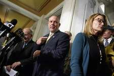 Democratic House Speaker Joe Aresimowicz, center, points toward Republican House Minority Leader Themis Klarides, right, after a news conference in which it was announced that a bipartisan budget deal was near completion on Wednesday, Oct. 18, 2017, in Hartford, Conn. Connecticut legislative leaders announced Wednesday they've reached a tentative agreement on most major parts of a new, bipartisan state budget deal, moving closer to possibly ending an impasse that has dragged on for months.