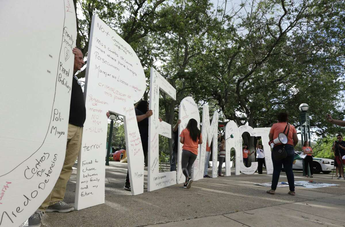 """A list of hard-line demands from Trump jeopardizes a bill to allow immigrants brought here as children to stay. Here, immigrant rights supporters hold giant letters as they demonstrate in favor of Congress passing a """"Clean Dream Act."""""""