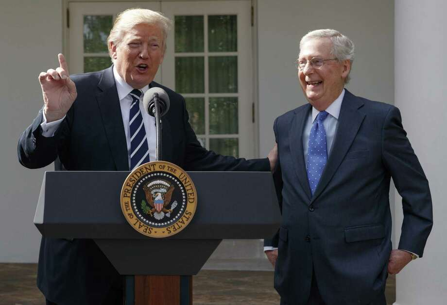 A reader reflects on President Donald Trump's character. Here, he and Senate Majority Leader discuss their relation ship. Photo: Evan Vucci /Associated Press / Copyright 2017 The Associated Press. All rights reserved.
