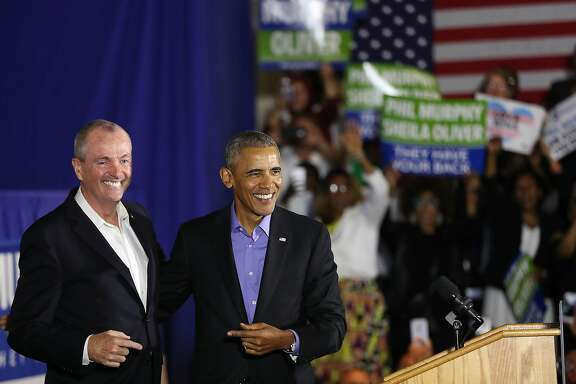 NEWARK, NJ - OCTOBER 19:  Former U.S. President Barack Obama (right) stands on stage with Democratic candidate Phil Murphy, who is running against Republican Lt. Gov. Kim Guadagno for the governor of New Jersey, on October 19, 2017 in Newark, New Jersey. In Obama's first return to the campaign trail, the former president is stumping for Democratic gubernatorial candidates in New Jersey and Virginia as they prepare for next month's elections. (Photo by Spencer Platt/Getty Images)