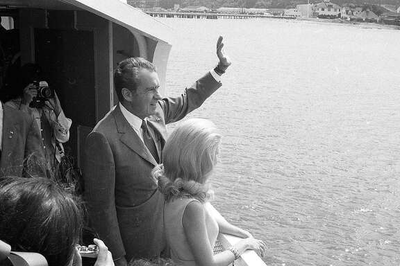 Sept. 5, 1972: President Richard Nixon waves to another boat while on board a ferry in San Francisco Bay, where he was promoting his environment-friendly positions.
