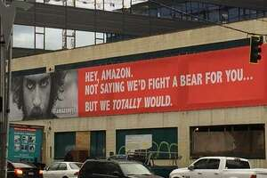 The city of Calgary, Alberta, unveiled this billboard near Amazon headquarters in Seattle on Thursday, Oct. 19, 2017.
