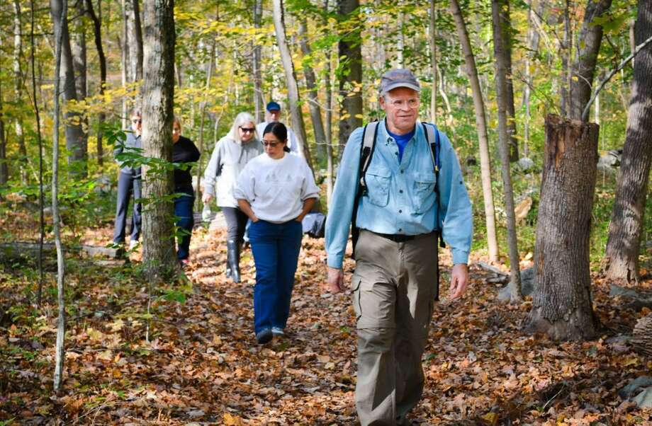 Sabina Harris, chair of Tree Conservancy of Darien, Conn. follows forest therapy guide Jeffrey Wyant during Shinrin-yoku walk. Photo: Contributed Photo / Contributed Photo / Darien News contributed
