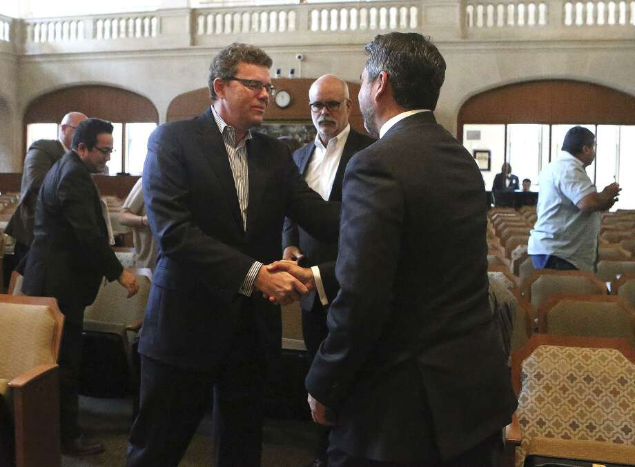 Credit Human President and CEO Stephen Hennigan shakes hands Oct. 19 with San Antonio city councilman Roberto Trevino, right, at city council chambers after tax abatements and other incentives were granted for Credit Human to relocate to the Pearl. The package raises questions. Photo: John Davenport /San Antonio Express-News / ©John Davenport/San Antonio Express-News