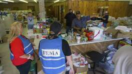 Marcus Torres gives the lay of the land to FEMA workers in Tivoli, TX, Tuesday, Sept. 12, 2017. Tivoli, an unincorporated town located between Port Lavaca and Rockport, was hit hard by Hurricane Harvey.  (Mark Mulligan / Houston Chronicle)