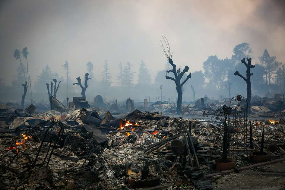 Homes are seen burnt to the groud after a fire tore through the Journey's End mobile home park on Mendocino Anvenue in Santa Rosa, Calif., on Monday, Oct. 9, 2017.