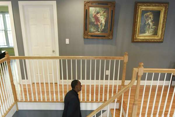 Vince Faust walks up the stairs in his home on Hope Street in the Springdale neighborhood of Stamford, Conn. Tuesday, Oct. 17, 2017. Listed at just above $1 million, this stone front Colonial four bedroom home sits on half an acre near the Merritt Parkway.