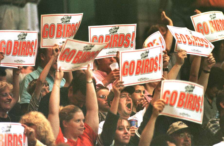 ALBANY FIREBIRDS  fans hold up signs and chant during their game against the Orlando Predators  in the 1999 ARENA BOWL XIII at the PEPSI ARENA, SATURDAY August 21, 1999. (Times Union photo by MICHAEL P. FARRELL) Photo: MICHAEL P. FARRELL / ALBANY TIMES UNION