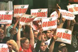Times Union photo by MICHAEL P. FARRELL --ALBANY FIRE BIRDS fans hold up signs and chant during their game against the Orlando Predators in the 1999 ARENA BOWL XIII at the PEPSI ARENA , SATURDAY August 21, 1999 at 6:10 pm.