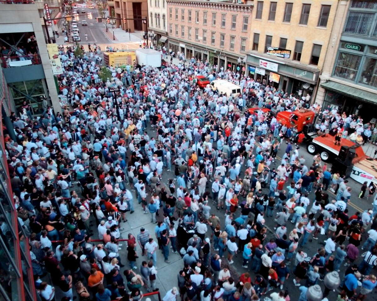 Thousands of arena football fans attend a pregame block party in front of Pepsi Arena in Albany on May 15, 1999.