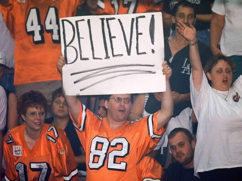 A look back at the history of arena football in Albany...Albany Firebirds fans celebrate a semifinal victory in the Arena Football League playoffs on Aug. 14, 1999 against the Arizona Rattlers at Pepsi Arena in Albany. Photo: JAMES GOOLSBY, DG / ALBANY TIMES UNION