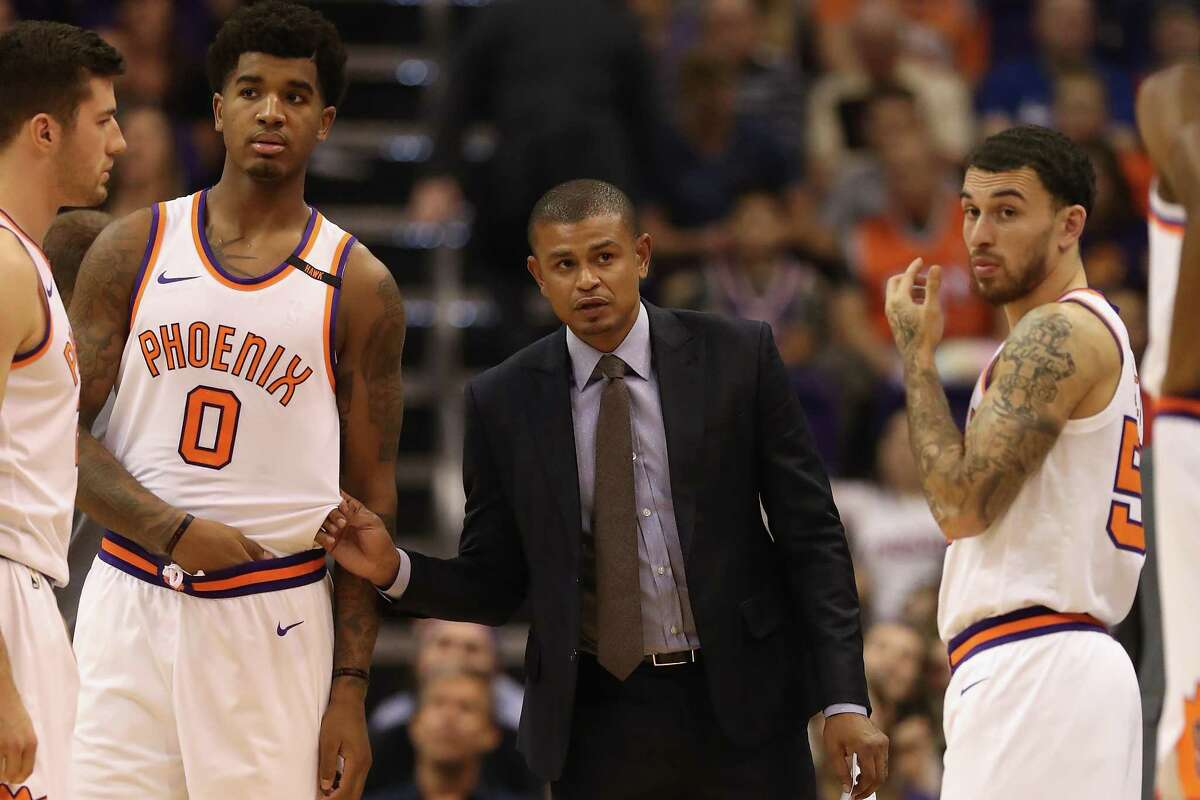 PHOENIX, AZ - OCTOBER 18: Head coach Earl Watson of the Phoenix Suns talks with Marquese Chriss #0 and Mike James #55 during the second half of the NBA game against the Portland Trail Blazers at Talking Stick Resort Arena on October 18, 2017 in Phoenix, Arizona. The Trail Blazers defeated the Suns 124-76. NOTE TO USER: User expressly acknowledges and agrees that, by downloading and or using this photograph, User is consenting to the terms and conditions of the Getty Images License Agreement.