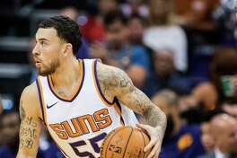 Phoenix Suns guard Mike James (55) drives to the basket against the Portland Trail Blazers during the second half of an NBA preseason game Wednesday, Oct. 11, 2017, in Phoenix. Portland won the game ?113-104. (AP Photo/Darryl Webb)