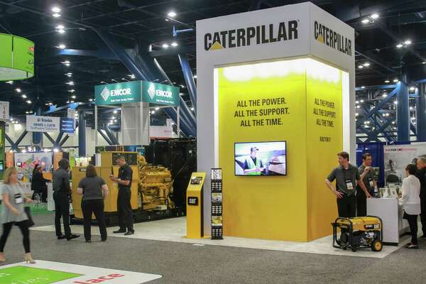 Caterpillar displays rental generators at the International Facility Management Association convention.