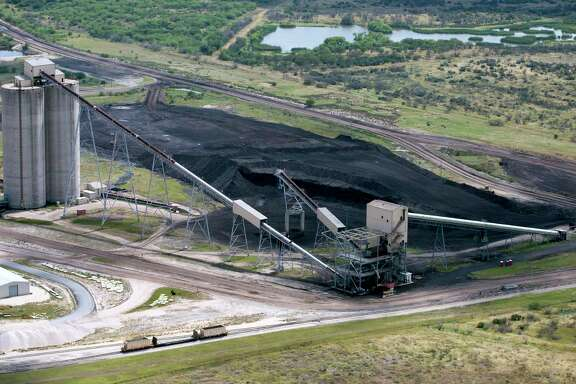 The on-site lignite coal pile for the San Miguel power plant near Campbellton, Texas is seen in this May 17, 2017 aerial photo. (San Antonio Express-News)