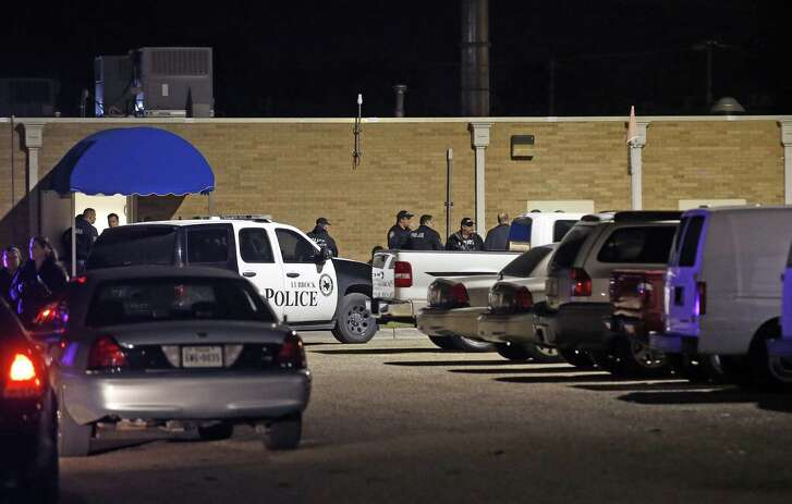 """Police officers work the scene of a shooting at the Texas Tech Police Department after a campus was shot and killed Oct. 9. Police arrested Hollis """"Reid"""" Daniels III of Seguin later that night."""