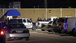 "Police officers work the scene of a shooting at the Texas Tech Police Department after a campus was shot and killed Oct. 9. Police arrested Hollis ""Reid"" Daniels III of Seguin later that night."