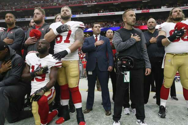 49ers CEO Jed York (center)  stands with his team in solidarity during the anthem prior to a game against the Cardinals at the University of Phoenix Stadium.