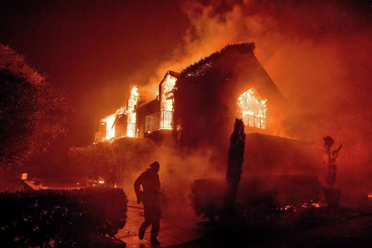 Flames consume a building on the Signorello Vineyards property in Napa on Monday, October 9, 2017.