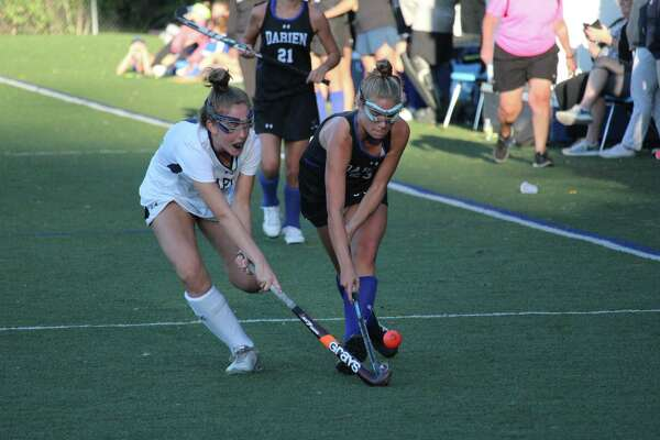 Darien's Kathleen Tropsa drives to the goal as Staples' Grace Cooper defends during the 2-1 Wreckers win.
